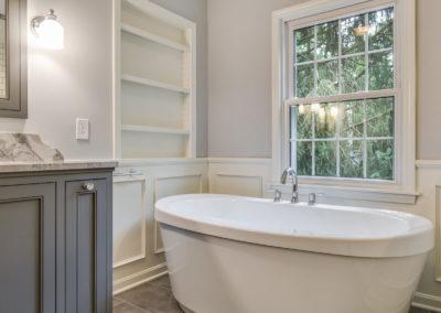 freestanding soaker tub by window
