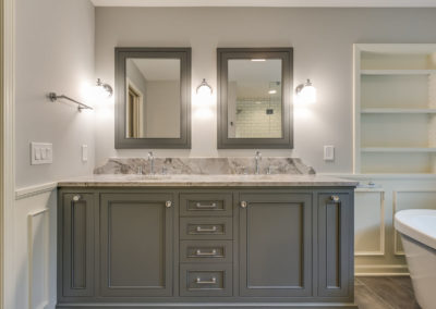 gray double sink vanity with crystal knobs