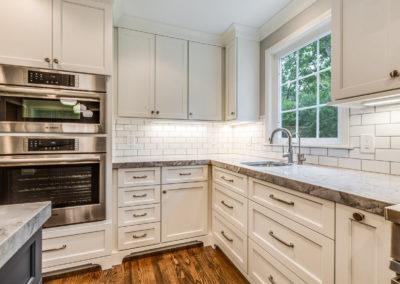 white kitchen cabinets with subway tile backsplash