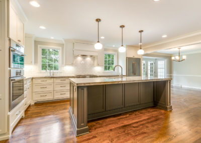 remodeled white kitchen with center island