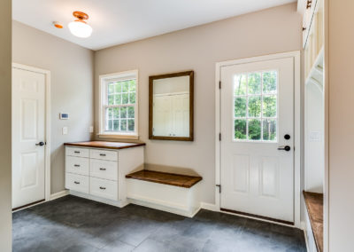 mudroom entry with built in bench and counter