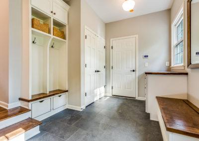 luxury mudroom renovation with built in bench and storage