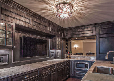 luxury kitchen renovation with dark wood cabinetry