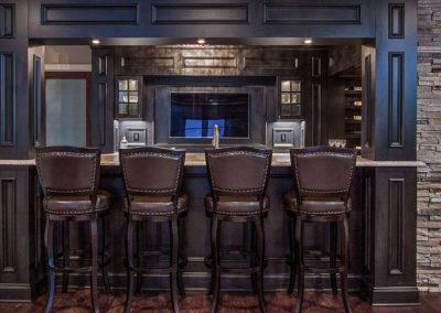dark wood bar with stool seating