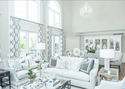 bright white living and dining room with large windows