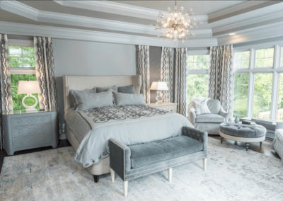 gray master bedroom with tray ceiling