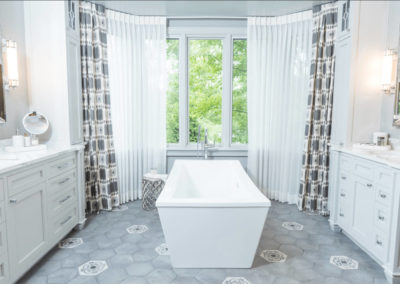 remodeled bathroom with freestanding square tub