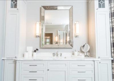white bathroom vanity with tower storage