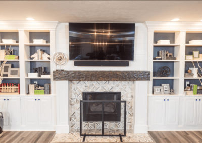 living room fireplace surrounded by white built ins