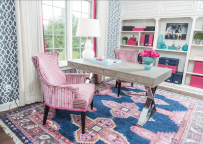 home office with navy, pink and teal color scheme