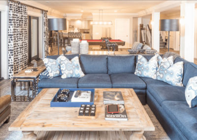 living room remodel with blue sectional and square coffee table