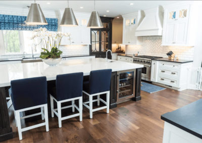 navy blue and white stools at large kitchen island