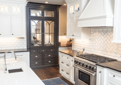 colonial kitchen remodel with white cabinetry and brown dog laying on rug