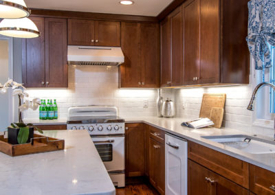 brown kitchen cabinets with retro white appliances