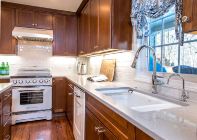 brown shaker style kitchen cabinets and white subway tile backsplash