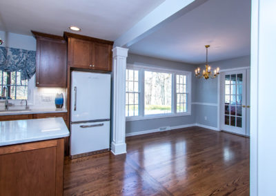 kitchen open to dining room with chandelier