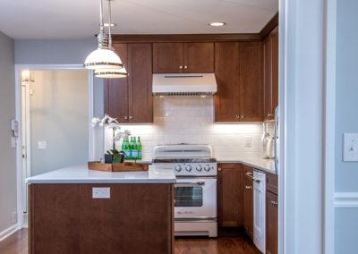 kitchen island with white pendant lighting