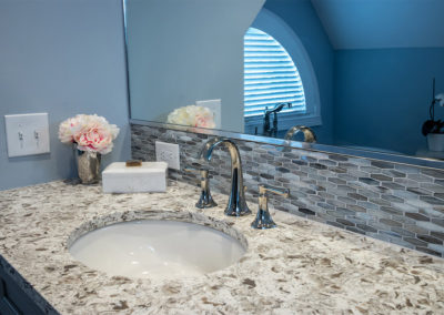 master bathroom vanity with white and brown counter