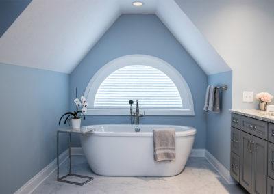 light blue master bathroom with freestanding tub