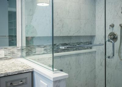 glass doors of tiled shower in master bath remodel