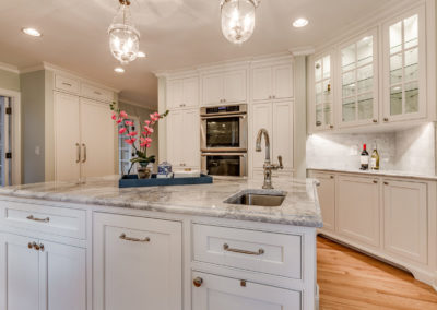 white kitchen remodel with center island