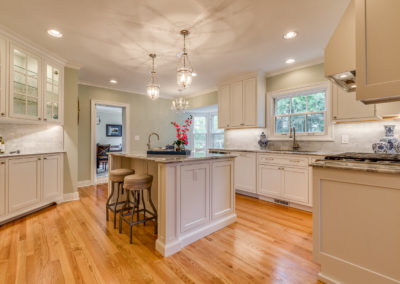 kitchen renovation with dual sinks and recessed lighting