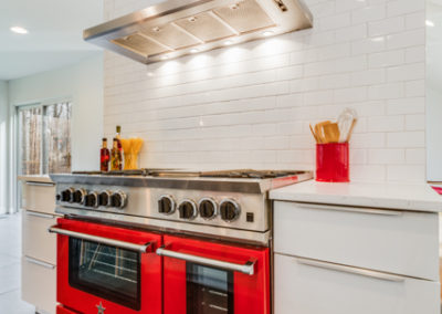 bluestar red oven and gas range in modern kitchen