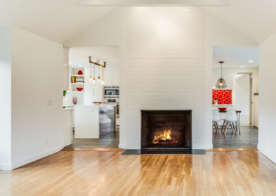 modern living area with white fireplace