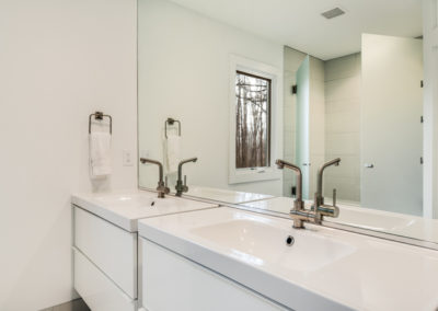 modern white bathroom remodel with double sinks