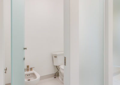 white bathroom with frosted glass door