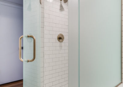 white subway tile shower with octagonal tile floor