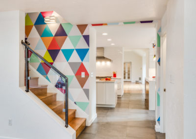 modern staircase with multicolored triangle pattern wallpaper