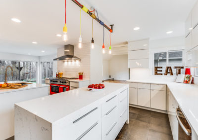 white modern kitchen remodel with red oven