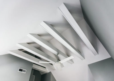 white exposed beams in vaulted ceiling
