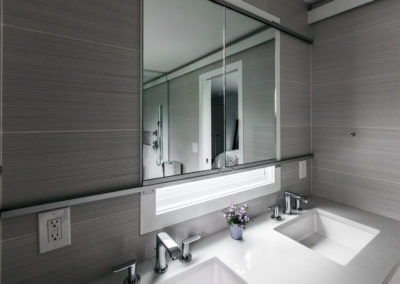 modern gray bathroom with double undermounted sinks