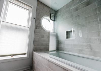 bathroom tub with glass door