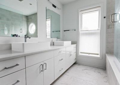 master bathroom white vanity with double raised sinks