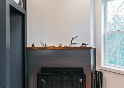 small fireplace with gray surround