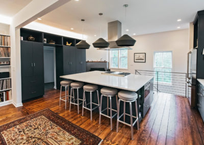 black kitchen cabinets with large seating island