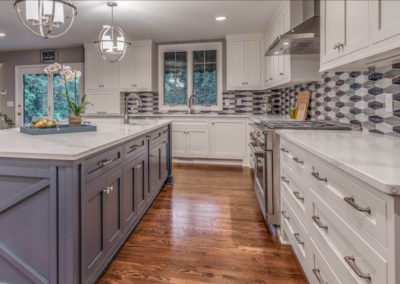 two toned kitchen remodel with gray and blue backsplash