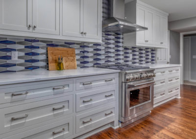 kitchen remodel with gray cabinets and patterned backsplash