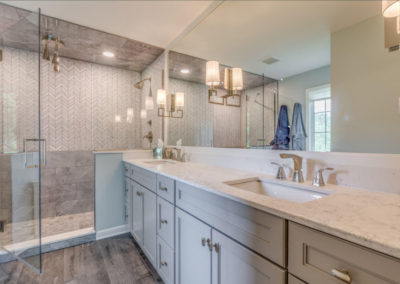 master bathroom with double sinks and large mirror