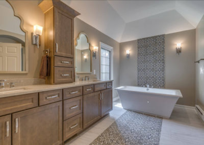master bathroom with double sink vanity and freestanding square tub