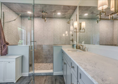 luxury master bathroom shower with mixed gray tile patterns
