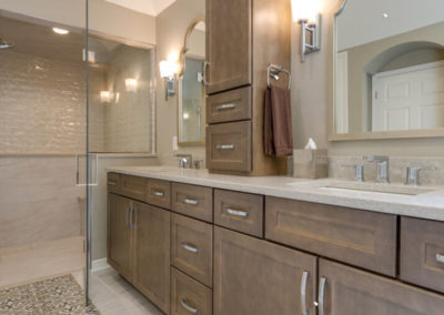 wood vanity with double sinks and center storage tower