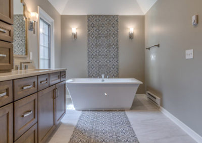 transitional master bathroom with patterned tile