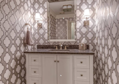half bath with gray patterned wallpaper