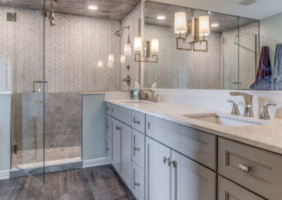 master bathroom with double sink vanity and glass door shower