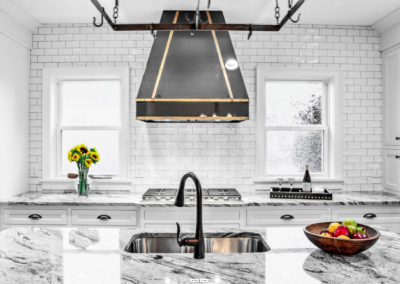 modern kitchen with black and gold accent colors