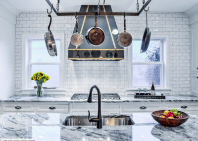 modern kitchen with black and gold stove range hood